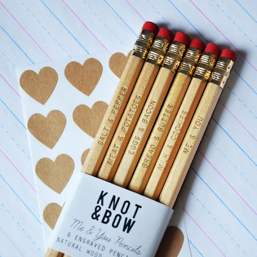 So cute!   http://www.etsy.com/listing/62722740/me-you-pencils-gold-engraved-natural