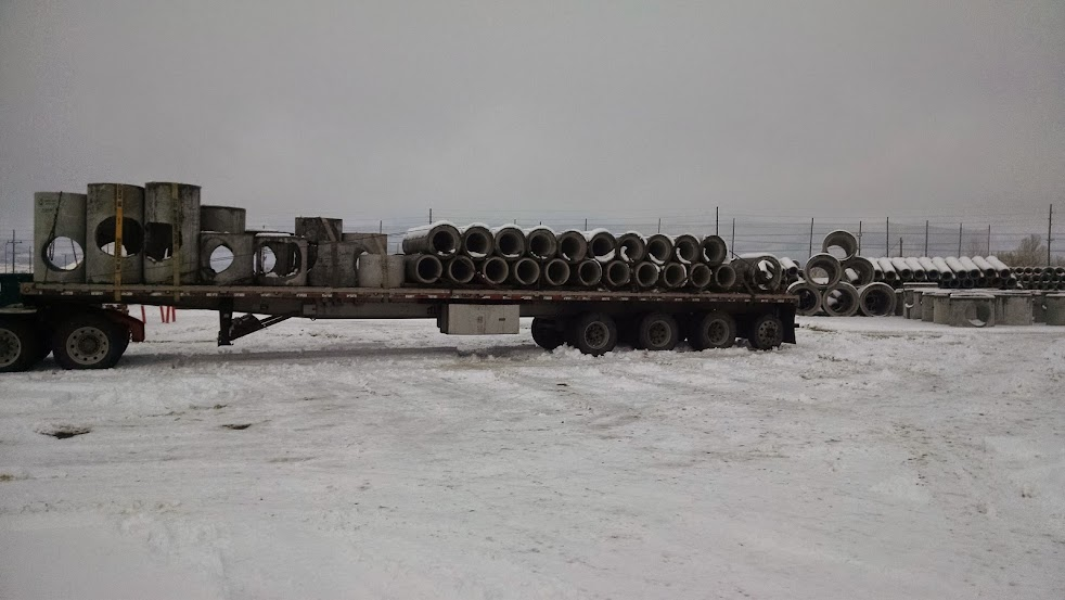 flatbed trailer loaded with cement pipe