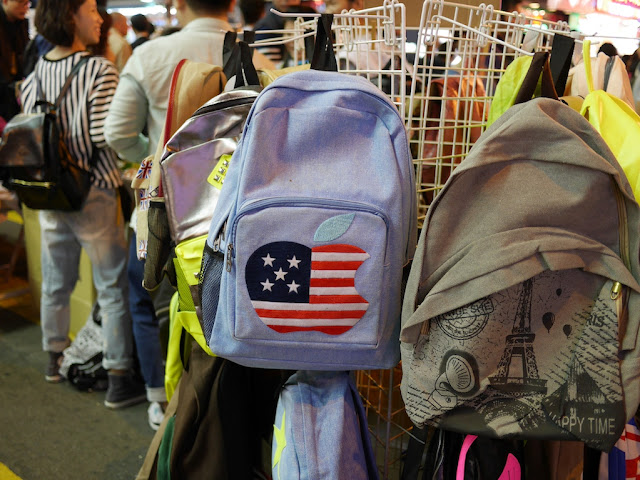 bag with a US flag colored Apple logo at Sai Yeung Choi Street South