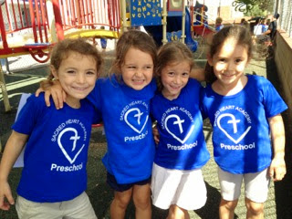 Students of the Sacred Heart Academy Preschool standing together on a playground