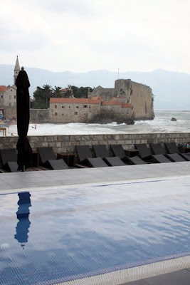 Swimming pool and city walls in Budva Montenegro