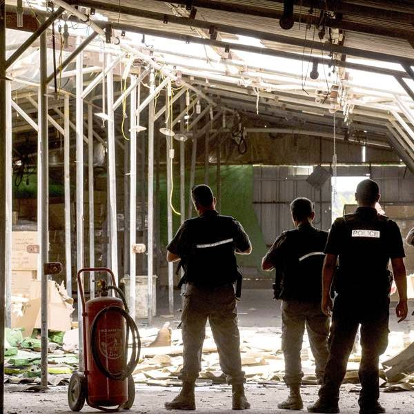 Israeli bomb disposal experts inspects the damage inside a shed following a mortar attack by militants from the Gaza Strip on the southern Israeli kibbutz of Nir Am.