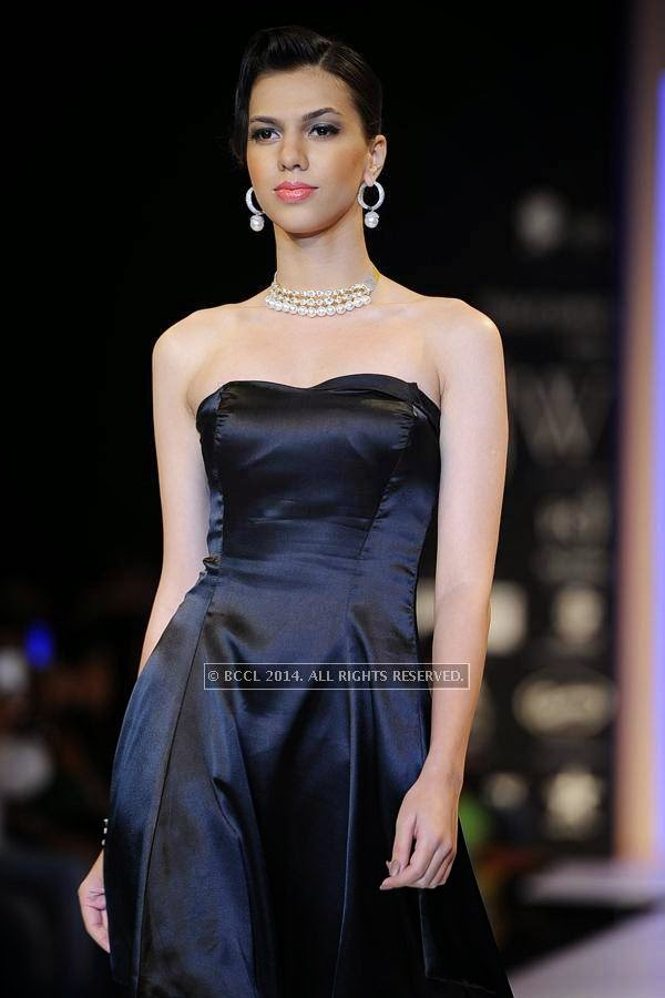 A model walks the ramp for AKS Jewels on Day 2 of India International Jewellery Week (IIJW), 2014, held at Grand Hyatt, in Mumbai.