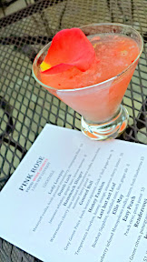 Hearing the music of modern troubadour Brian McGinty from NW Lovejoy and 13th on the patio of the Pink Rose with the cocktail Lady Lovejoy with Medoyeff vodka, fresh pressed strawberry and champagne float