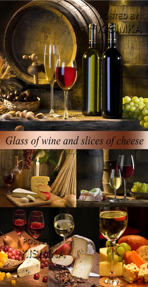 Stock Photo: Glass of wine and slices of cheese