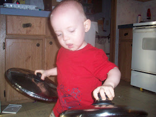 Busy Toddler playing with pans