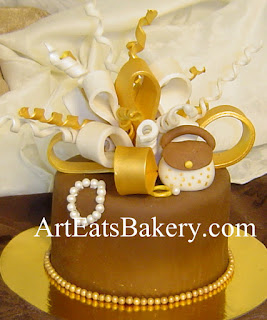 Ladies brown fondant unique birthday cake with gold and white bows, pearls, ring and handbag