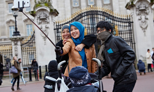 Generic selfie stick being used outside a famous British tourist attraction