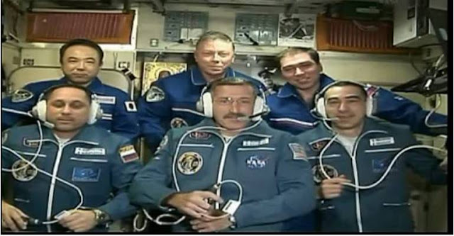 Russia:   The icon of the Mother of God in space together with Russian astronauts
