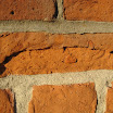 Unprotected brick damaged from flaking and spalling due to water absorption.  A-Tech Masonry and Brick Sealer protects brick by repelling water.