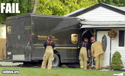 photo of a UPS truck crashed into a house