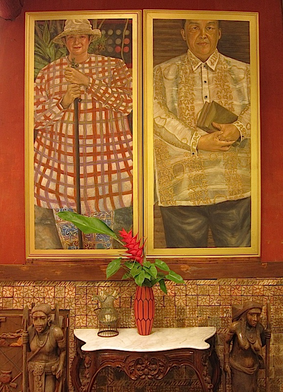 portraits of Patis and Tito Tesoro in the main dining room of Patis Tito Garden Café
