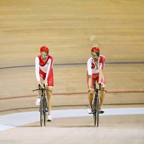 British cyclists Bradley Wiggins (R) and Andy Tennant ride past during a training session at the Sir Chris Hoy Velodrome at the Emirates Arena in Glasgow on July 22, 2014, ahead of the start of the 2014 Commonwealth Games which begin on July 23, 2014.