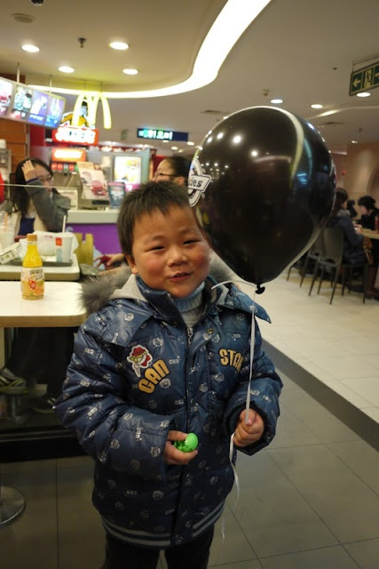 little boy with a Dickies balloon