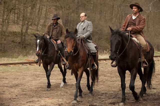 Rhys Ifans as Galloway, David Dencik as Buchanan and Bradley Cooper as George Pemberton in Serena