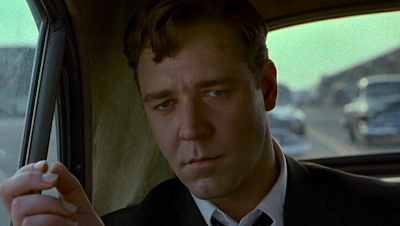 Russell Crowe as John Nash in the early scenes of the film A Beautiful Mind when he was an extremely cocky code breaker.