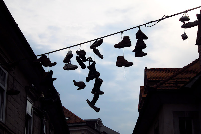 Shoes hanging from power lines