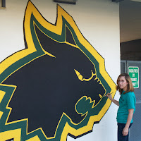 Erica Honles completing painting of Mural