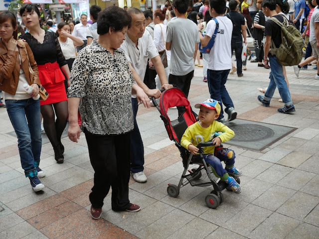 older couple with child in a stroller