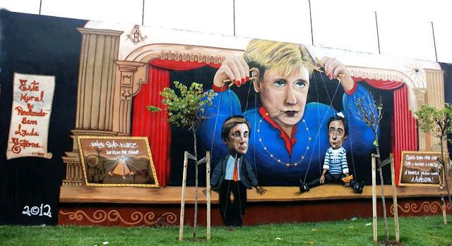Murais de protesto em Lisboa contra a visita de Angela Merkel