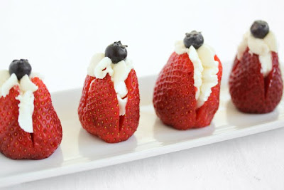 photo of four stuffed strawberries on a plate