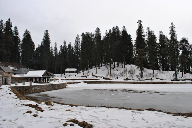 Fresh snowfall on the trek to Kamrunaag Temple in Mandi Districtof Himachal Pradesh : Posted by VJ SHARMA on behalf of Ashutosh Thakur on www.travellingcamera.com : It was Jan end when one of my friend planned a family outing to Kamrunaag Temple in Mandi District of Himachal Pradesh. One needs to trek through villages and forests to reach the temple on top of a hill ! Kamrunag Lake, situated 9100 feet above in Mandi district... Here are few photographs by Ashutosh from his last trip and snow-fall made the trip more interesting.. Check out !!!There is a small lake in front of Kamrunaag temple which was frozen during the time Ashutosh visited the place...Another wonderful photograph of frozen lake in front of Kamru-Naag Temple in Mandi, Himachal Pradesh ! Kamrunag is well known Lord Of Rain in Mandi district of  Himachal Pradesh and people visit thisevery year on SAZA (First Day Of Month as per Local calendar) of June and July. June & July are best months to visit this holly place. However one can visit it up-to November before having snowfall and cold there... and of course, people who love snowfall and adventure try to visit it during winters !!!Here you see Kamaru-Naag Temple on the left side of the frozen lake in front of it.. Normally folks throw some coins into the lake to prey something for future and sometimes commit to come back when their wish come true !Ashutosh, who shared all these photographs on PHOTO JOURNEY !!! Thanks Ashu !'Shradhalu' walking bare feet on snow to reach Kamru-Naag Temple in Mandi.. This temple has a great importance and many folks from various parts of Himachal and outside come here... and for last few years, people have been visiting the place for adventure and most of them like it... Hope that the area around this place remains clean as it is today...A typical Himachali styled house on the way to Kamaru-nag...Kamru Nag is in Mandi  district and if one starts from Mandi town, Sundernagar would be the next place at a distance of about 24 Kms. And from there Karsog road needs to be followed. The trek would start from Rohanda that is about 50 Kms from Sundernagar. During the trek from Rohanda to kamru Nag, one can have amazing panoramic views of the valley. Being a very famous tourist attraction, the lake in front of this temple is also of religious importance as the Kamrunag Temple is situated on the banks of the lake and the Kamrunag religious fair is held every year around this lake...Kamaru Nag Temple with a beautiful lake in front of it is situated on a hill-top with wonderful views of surroundings...Lovely view of Kamru Nag Lake in Mandi District of Himachal Pradesh !!! Snowfall has made it more beautiful... Imagine the same place in autumn colors...Thousands of devotees visit  the historical temple of Kamrunag, situated on a hilltop at a height of 9000 feet on the bank of Kamrunag Lake, on the occasion of Kamrunag fair...