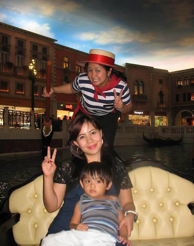 mother and child on the gondola with a gondolier at the Venetian Macau