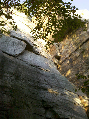 Rope set up on the face, with the crack to the right.