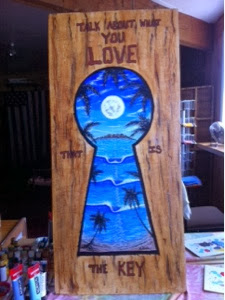 a positive painting on wood with keyhole and surf art