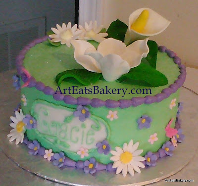 Girl's green and purple butter cream birthday cake with white, purlpe and pink edible fowers and butterflies