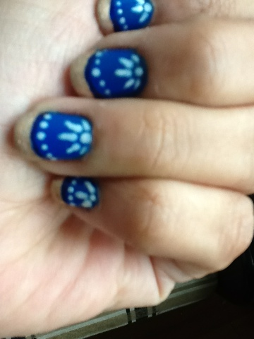 blue nails with gold tips and flowers