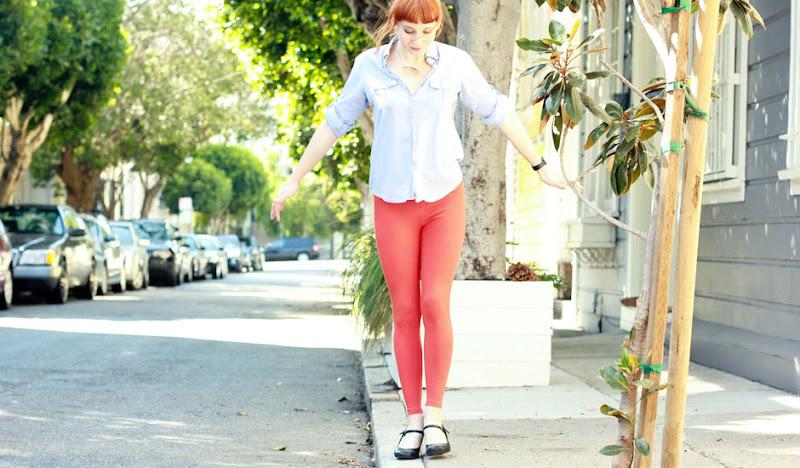 Orange Leggings walk curb's edge