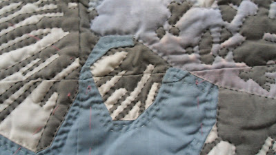 Shubunkin fish, hand appliqué and quilting. Close up of the hand stitching on the fish's fins