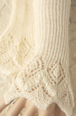 Knitted lace cuffs