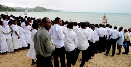 Young people waiting to be baptized.