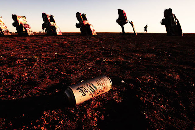 A discarded spray paint can for Cadillac Ranch graffiti and the Cadillacs in the background.