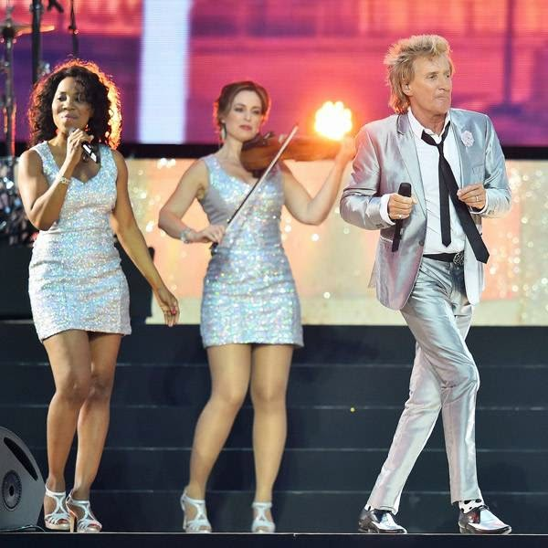 Singer Rod Stewart performs during the opening ceremony of the 2014 Commonwealth Games at Celtic Park in Glasgow on July 23, 2014.