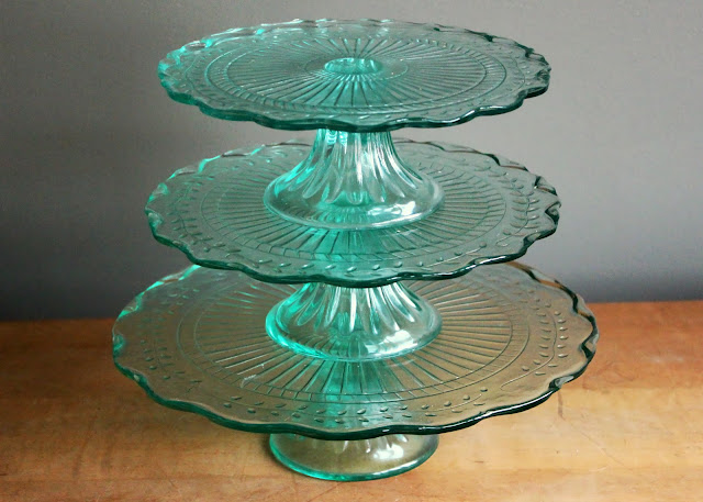 Blue cake stands available for rent from www.momentarilyyours.com, $5 for large, $4 for medium, $3 for small.