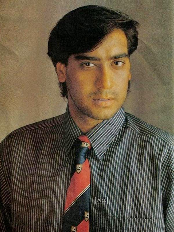 With average looks but deep eyes, Ajay Devgn began his career with Phool Aur Kaante in 1991 and received a Filmfare Award for Best Male Debut for his performance. Click next to see how he looks now!