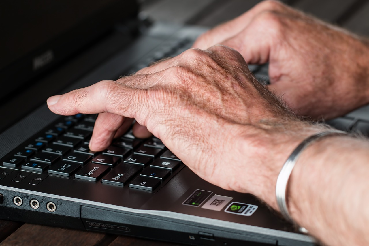 a person typing something on a laptop