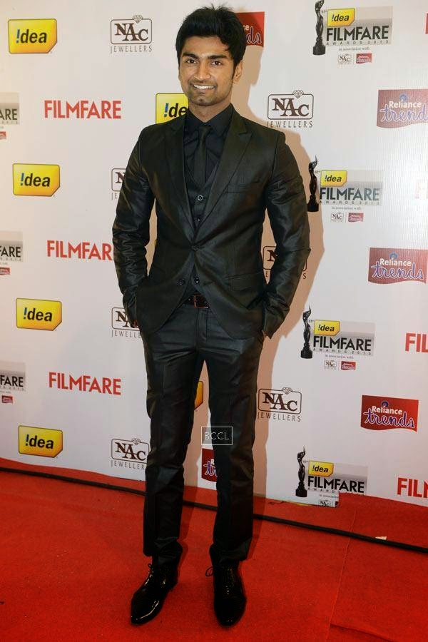 Atharvaa poses as he arrives for the 61st Idea Filmfare Awards South, held at Jawaharlal Nehru Stadium in Chennai, on July 12, 2014.
