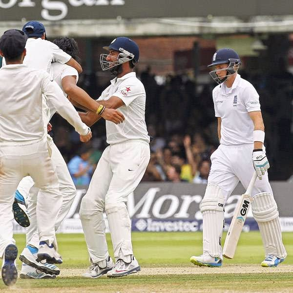India's Ishant Sharma (3rd L) celebrates taking the wicket of England's Joe Root (2nd R) for 66 runs on the fifth day of the second cricket Test match between England and India at Lord's cricket ground in London on July 21, 2014.