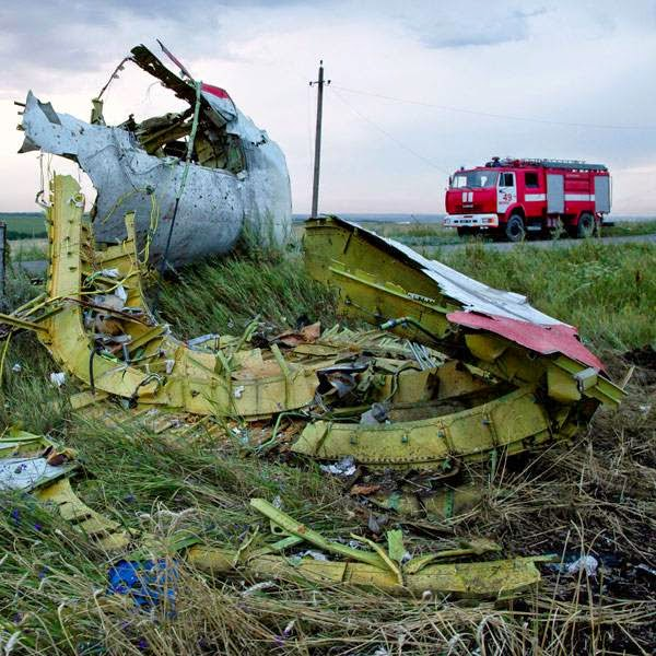 Fire engines arrive at the crash site of a passenger plane near the village of Grabovo, Ukraine, as the sun sets Thursday, July 17, 2014. The Malaysian airliner Flight MH-17 was brought down over eastern Ukraine on Thursday, killing all 295 people aboard and sharply raising the stakes in a conflict between Kiev and pro-Moscow rebels in which Russia and the West back opposing sides.