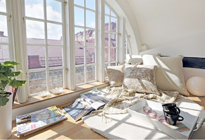 http://www.apartmenttherapy.com/inspiration-a-floorlevel-windo-91158