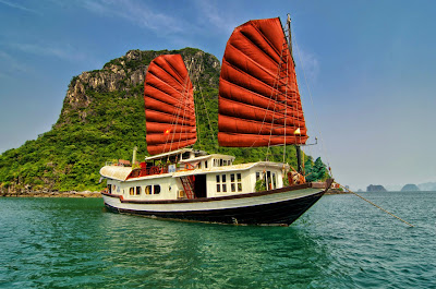 Prince Junk ~ youthful and fun, the family man on the water  The Prince junk was designed after the traditional fishing boats of Halong Bay, only on a slightly smaller scale with either 2 or 4 cabins. In our fleet, we have four Prince Junk:  Prince I has 2 cabins, absolutely suitable for a family of parents and children travelling together, cheering happiness of family in Halong Bay Prince II and III have similar design and service facilities to accommodate a group up to 8 persons, or couples sharing trips. Prince IV with 3 cabins provides nice comfortable stay for charter group or family, couple sharing boat. Like all of our boats, Prince Junk is designed with sophistication and a meticulous attention to detail for our guests' enjoyment. Featuring 2 decks with dining area inside and outside, nice decorated cabins with sea view window, you will have nice time relaxing on boat to admire marvelous Bay in your eyes. Our crew with their warmest hospitality surely adds to your impression list.