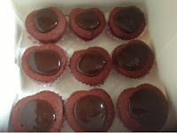 heart shaped red velvet cupcakes with chocolate topping