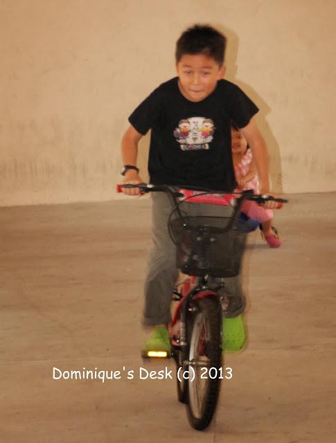 Monkey boy on his bike
