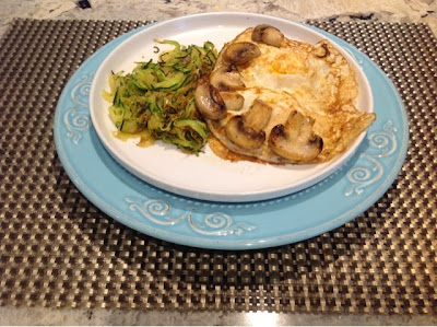 sprialized zucchini and mushrooms with a fried egg