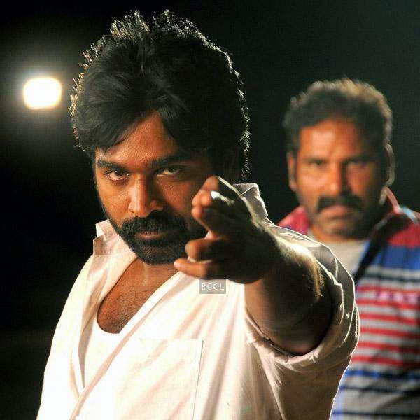 Vijay Sethupathi in a still from the Tamil movie Vanmham.