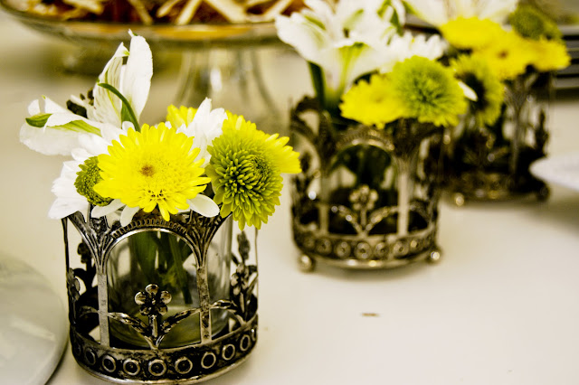 mini vase idea  using votive candle holders- The Style Sisters